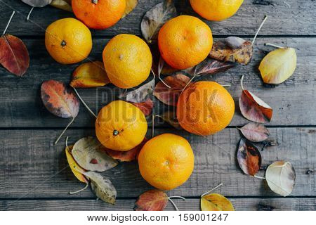 Fresh Mandarin Oranges Fruit With Leaves On Wooden Table.  Ripe