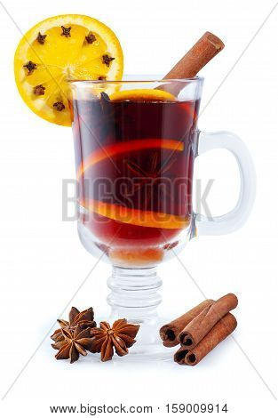 mulled wine with spices isolated on white background. Winter alcoholic cocktail. Mulled wine with slice of orange anise and cinnamon. Mulled wine isolated. Christmas drink