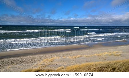 Beautiful coastal panorama - a lot of waves, sand and dunes