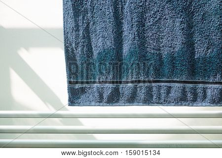 The Blue towel on a clothesline to dry.