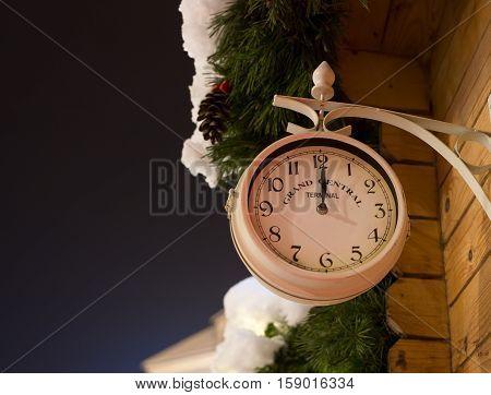 Station clocks on New Year midnight - making a wish for Santa