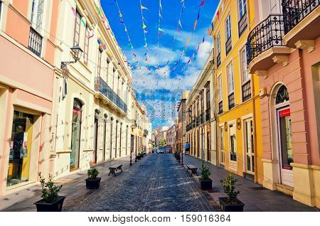 La Orotava Tenerife Spain- November 6 2016: City street in La Orotava decorated with colorful flags. Historical center and architecture of La Orotava. Tenerife Canary islands Spain.