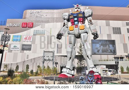 Tokyo, Japan - December 11, 2012: Full-size of RG 1/1 RX-78-2 Mobile suit Gundam Ver. GFT in front of DiverCity Tokyo Plaza at Odaiba in Tokyo, Japan. DiverCity Tokyo Plaza is a shopping mall.