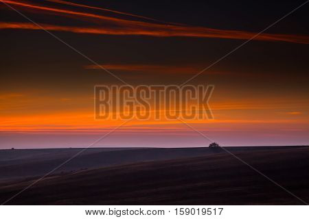 Beautiful evening sky over the fields after sunset