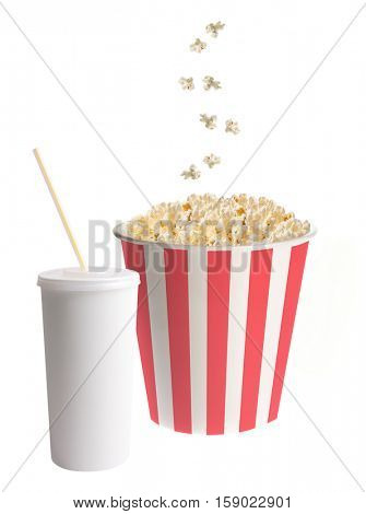 Soda cup with straw and popcorn falling into a classic striped bucket isolated on white background