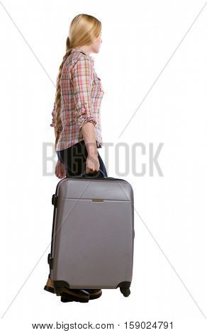 back view of walking  woman  with suitcase. beautiful girl in motion.  backside view of person.  Rear view people collection. Isolated over white background. Long-haired girl carries a huge suitcase.