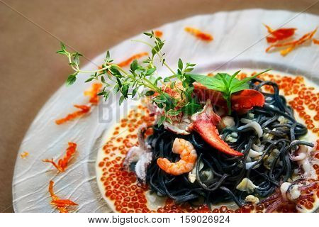 Black pasta with lobster cream sauce and caviar