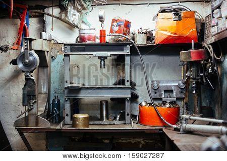 Garage or workroom of repairman with necessary equipment
