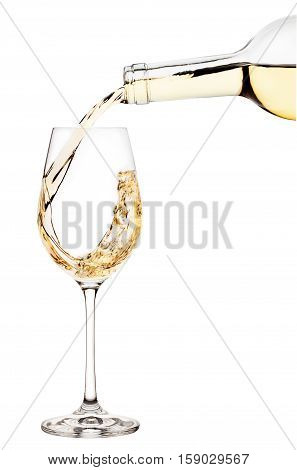 White wine is poured into wine glass isolated on white background