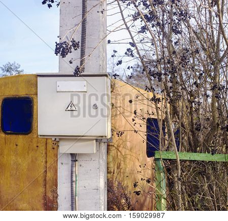 Close view of an electric meter box on the pole