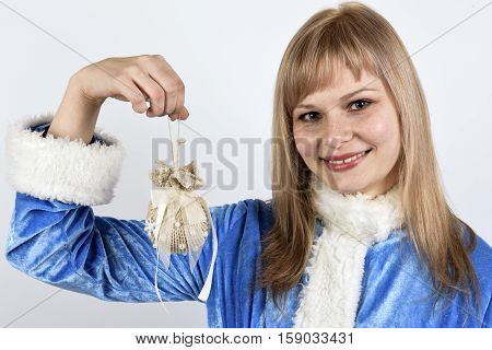 smiling snow maiden with bell in hand