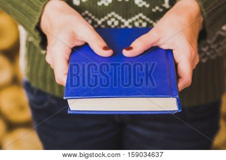 Adult Woman Holding Blue Book