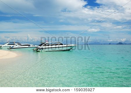 Motor boats on turquoise water of Indian Ocean Phi Phi island Thailand