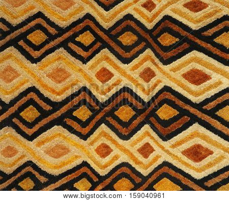 African embroidered straw background of rhomboid shape