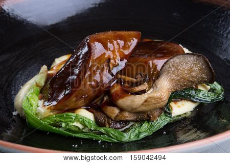 Beef tongue with mashed potato and spinach