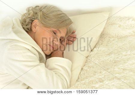Portrait of seniour woman sleeping in her bed
