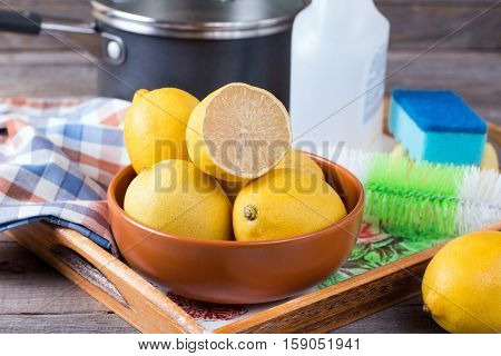 Lemon in the household on a wooden background