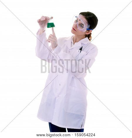 Female assistant scientist in white coat and plastic protective glasses over white isolated background inspecting flask filled with substance, healthcare, profession, science and concept