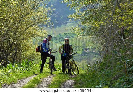 Man And Woman On Bike