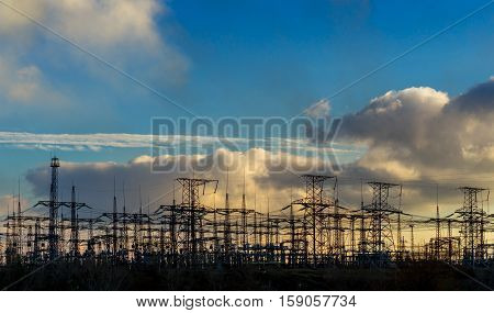 High voltage switchgear equipment small clouds at sunset