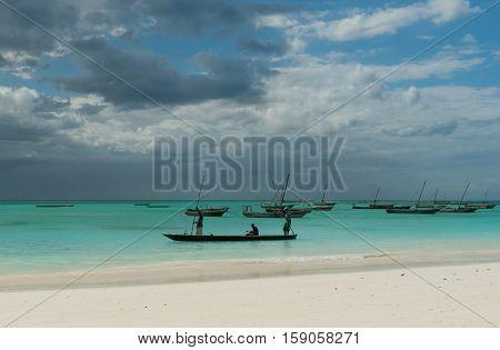 ZANZIBAR, TANZANIYA- JULY 13: fishermen near their boat on the shore on July 13, 2016 in Zanzibar