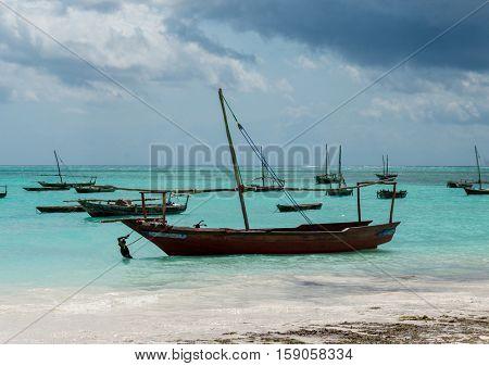 ZANZIBAR, TANZANIYA- JULY 18: beautiful landscape with fishing boats on the shore on July 18, 2016 in Zanzibar