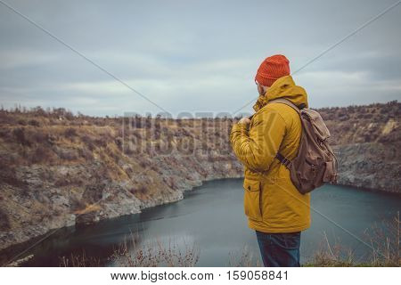 lake in could autumn wather with man