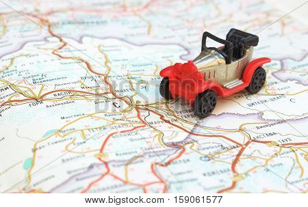 Image travel concept, small red, black car on map, travel