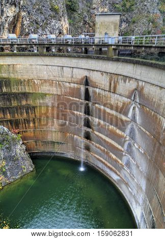 Water falls from the dam of hydroelectric power plant