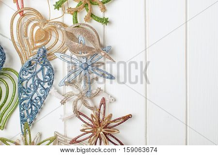 Christmas decoration on the wooden white backround. Winter holidays concept. Space for text.