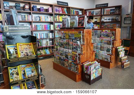 Customer Shops For Books In Phnom Penh Airport, Cambodia.