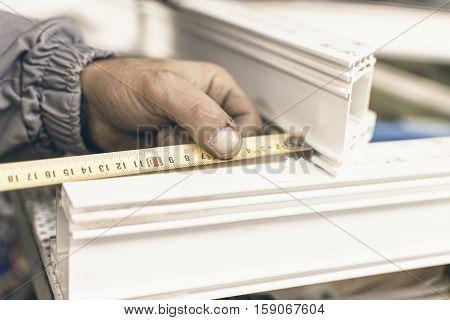 Worker Manufacture Window. Injured Hands From Manual Work And Meter. Plastic Window And Door Industr