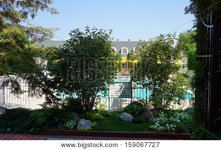 HARBOR POINT, MICHIGAN / UNITED STATES - AUGUST 3, 2016: The private swimming pool of the Little Harbor Club is for members and guests only.