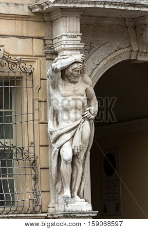 Statue of Hercules at the entrance to the 18th century Palazzo Vescovile (Bishops Palace) in the historical center of Mantua Ital