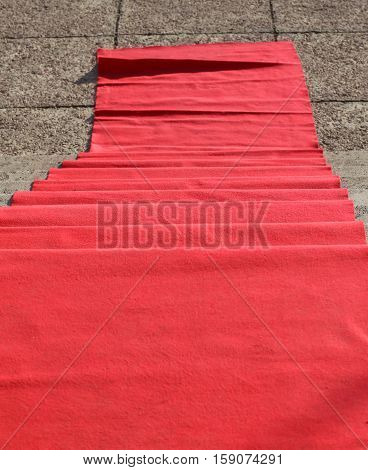 elegant long red carpet on the stairs at the vip fashion event