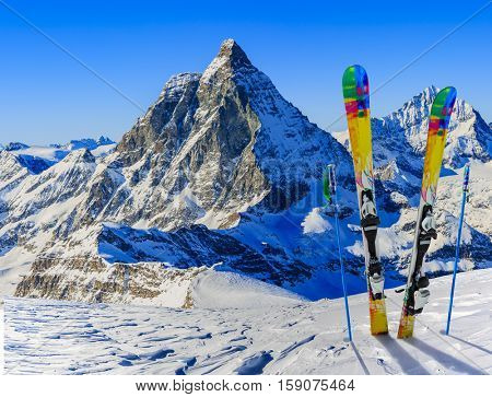 Ski in winter season, mountains and ski touring equipments on the top