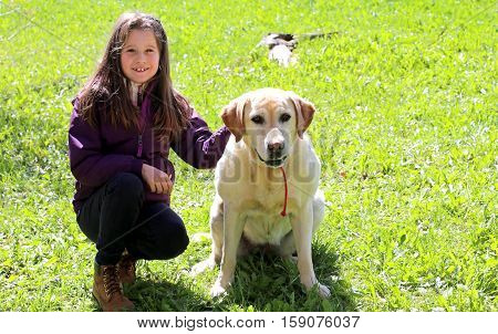 Beautiful Smiling Little Girl With Labrador Retriever Dog