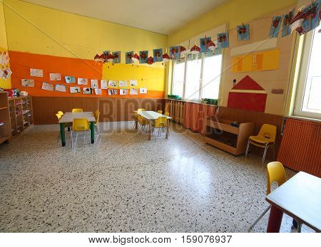 Classroom Of A Childhood Nursery With Drawings And The Tables