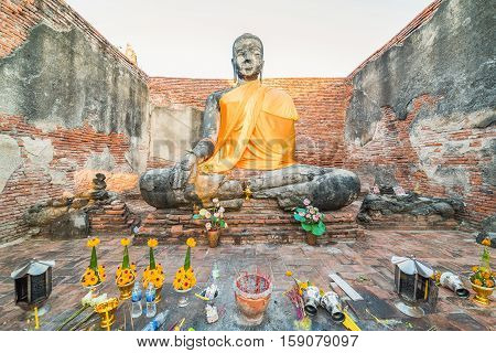 Asian Religious Architecture. Ancient Sandstone Sculpture Of Buddha At Wat Phra Sri Sanphet Temple R