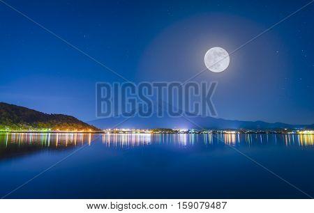 Midnight and Mt. Fuji full moon .