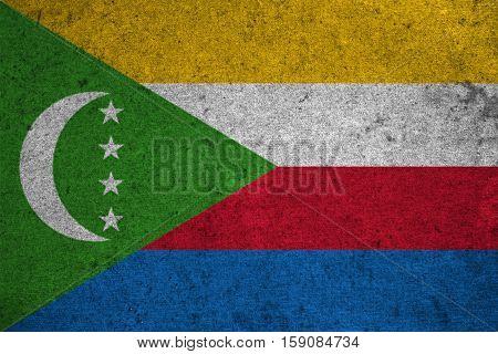 Comoros Flag On An Old Grunge Background