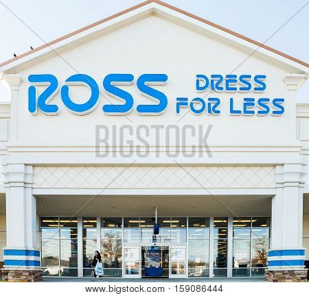 Fairfax, USA - November 27, 2016: Ross storefront with blue sign and person walking by entrance of store