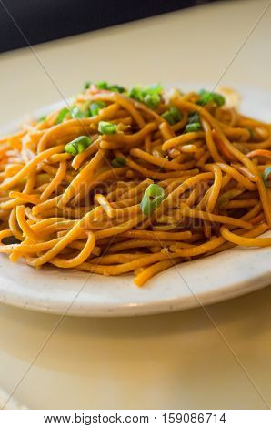 Chinese food tasty plain vegetable lo mein noodles at restaurant