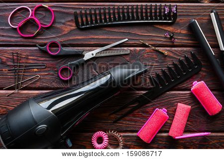 Barber Set, Hair Curlers, Scrunchies On The Wooden Background