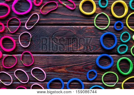 Colored Scrunchies On A Wooden Background Mockup