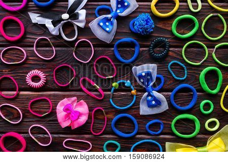 Background Of Colorful Scrunchies On The Wooden Background