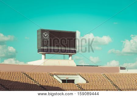 Score Board At Football Stadium With Bluesky , Vintage