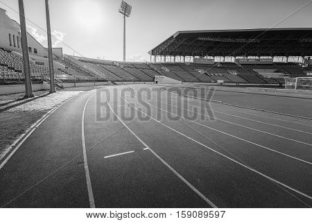 Red Running Track In Stadium , Black And White