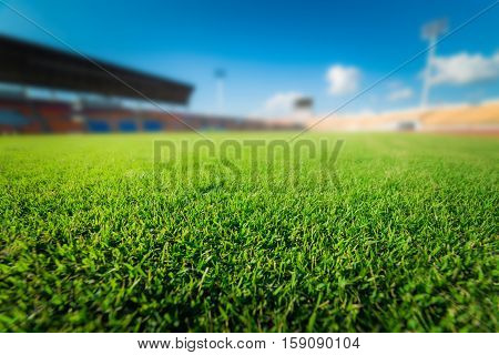 Green grass in soccer stadium at Thailand.