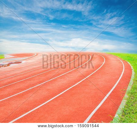 Running track in stadium on blue sky.